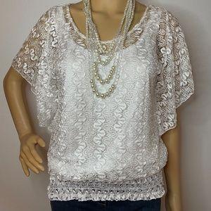 Crisp white lace flutter sleeved tunic top!